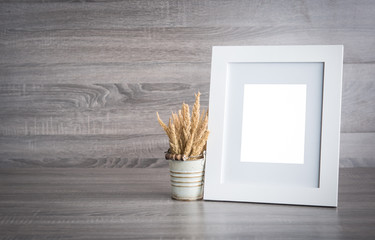 Photo frame on wood table with copy space