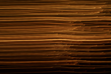 abstract background of the blurred lines of light on black