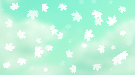 Maple leaves falling in front of cloudy sky