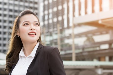 Business woman happy smile on something imaginary  look to success. concept working woman.