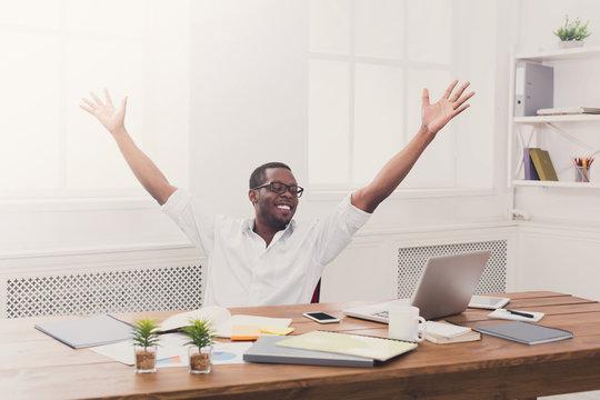 Happy businessman win. Winner, black man in office