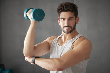 Young man using dumbbells