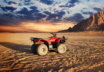 Quad bike in sand desert