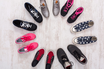 Bright and colorful sport shoes circle top view