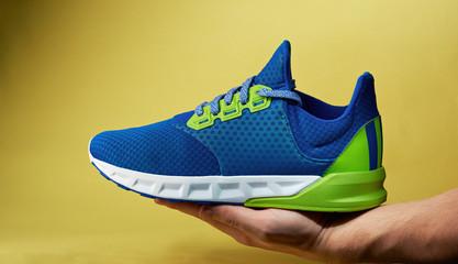 Sport shoe on hand