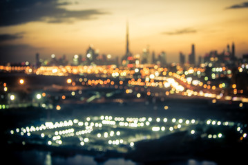 Blurred aerial view of Dubai at night time