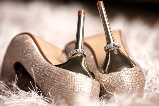 Elegant and stylish bridal shoes with wedding rings