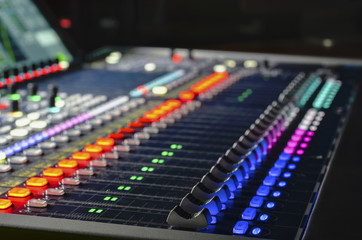 Digital studio sound mixer with backlit buttons