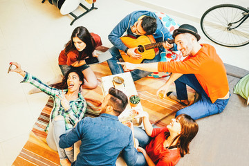 Group of  friends enjoying together playing music with guitar