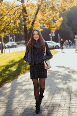 Young fashion girl walk on the street