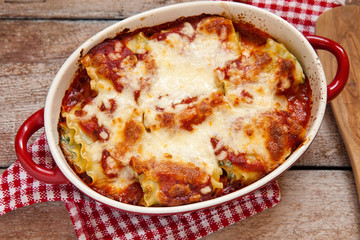 italian lasagna rolls with tomatoes spinach and ricotta cheese