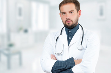 Male doctor with stethoscope in hospital. Healthcare