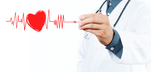Male doctor drawing heart symbol and chart heartbeat