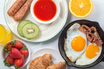 Nutritious breakfast, strawberry, bread, coffee orange juice, sausage, egg