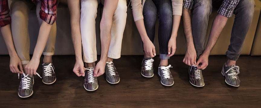 Putting on bowling shoes