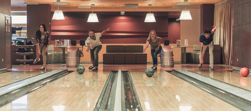 Friends playing bowling