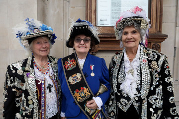 Women wear outfits and hats decorated with buttons during the Pearly Kings and Queens Harvest Festival at the St Martin-in-the-Fields church at the Trafalgar Square in London