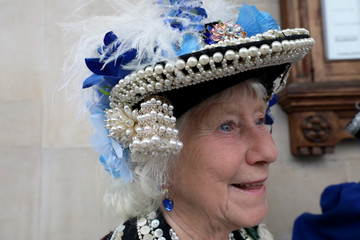A woman wears a hat decorated with pearls and buttons seen during the Pearly Kings and Queens Harvest Festival at the St Martin-in-the-Fields church at the Trafalgar Square in London