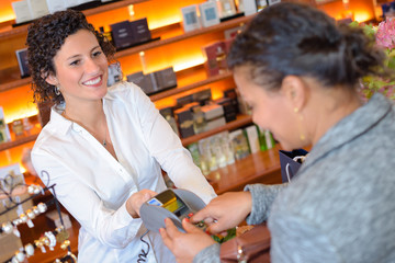 customer paying by card for cosmetics in store