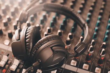 sound mixer and headphones. recording studio.