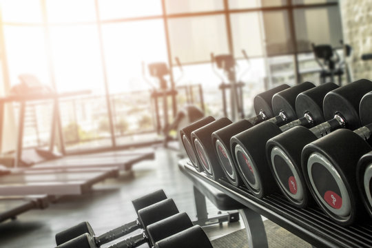 Pumping iron in the gym for bulking and weight building to get a bigger body.  Male fitness routines and workout patterns with protein.