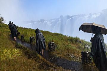 Wet Tourists At Victoria Falls