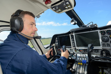 Pilot sat in cab of aircraft