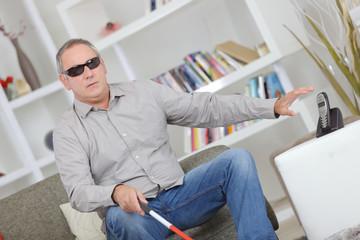 blind man sitting on a sofa