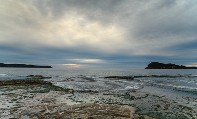 Cloudy Dawn Seascape with Rock Shelf