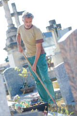 man cleaning a cementery