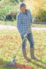 Man raking up leaves