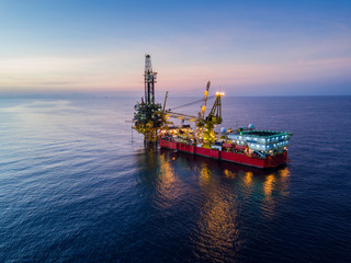 Wall Mural - Aerial View of Tender Drilling Oil Rig (Barge Oil Rig) in The Middle of The Ocean at Surise Time