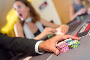 winner player playing poker a casino