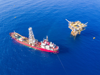 Wall Mural - Soil Boring Boat (a geotechnical drilling cum analogue survey vessel) close to a oil platform