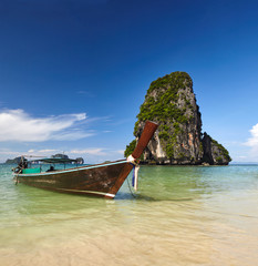 Sea view in Railay beach, Thailand to the assure sea, blue sky, rocks, and boat near cost