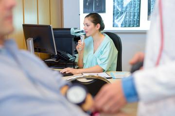 Nurse talking into dictaphone