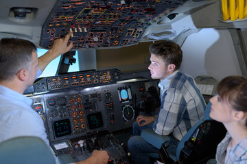 Young people learning about aircraft controls