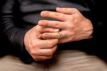 Man is taking off his wedding ring - divorce concept
