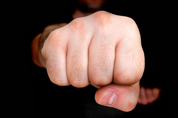 Photo sur Plexiglas Combat Young boxer showing punch a fist - martial arts concept
