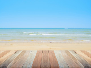 wooden table top with beach and sea backdrop, blank for design background