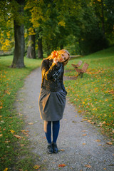 Young lady look out through bunch of leaves