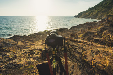 DSLR camera capturing sunset of seascape Khao laem ya, Thailand.