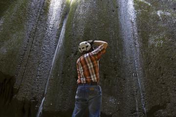 hiker take photo of waterfall