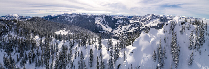 Aerial of Winter Resort from Snowy Peak in Cascade Mountain Range