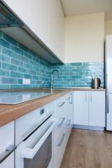 White glossy kitchen with modern appliances