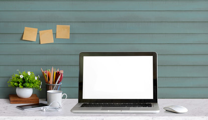 Stylish workspace with laptop computer, office supplies  at home or studio office. Mock up blank screen for graphic montage.