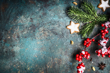 Christmas background with festive decoration, cookies and fir branches top view, place for text