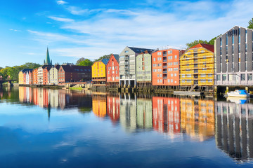 River Nidelva and historical timber buildings along the river in the norwegian city trondheim
