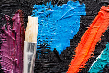 Abstract painting background with paintbrush. Wallpaper for a painter exhibition or paint factory