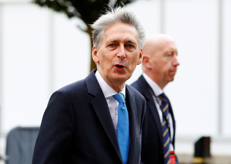 Britain's Chancellor of the Exchequer Philip Hammond arrives at the Conservative Party's conference in Manchester